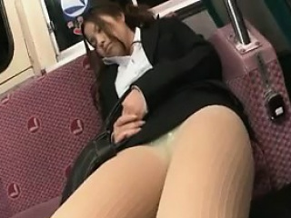 Pantyhosed Japanese girl rubs her peach while a guy strokes