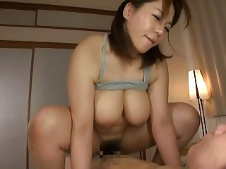 Chubby japanese Mitsuki An making good use of her tits