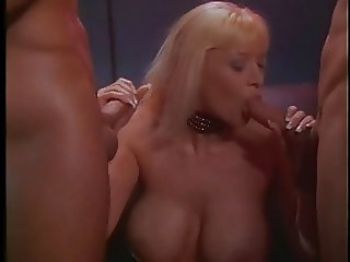 Platinum blonde rides a massive cock while giving head