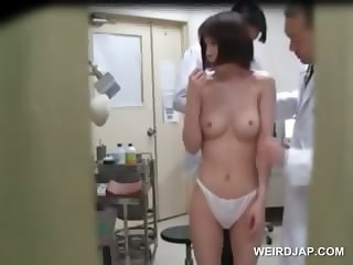 Teen cute asian strips in her undies at the gynecologist