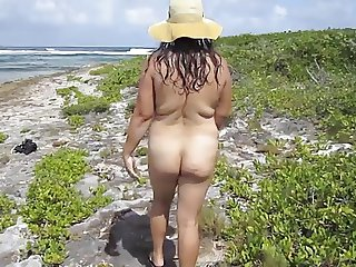 Asian walking nude on the beach atClub orient Orient beach