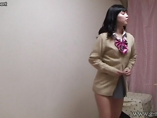 Naked Japanese Schoolgirl wears a Miniskirt School Uniform