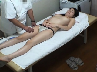 Pretty and lustful Asian girl is made to cum hard by a gift